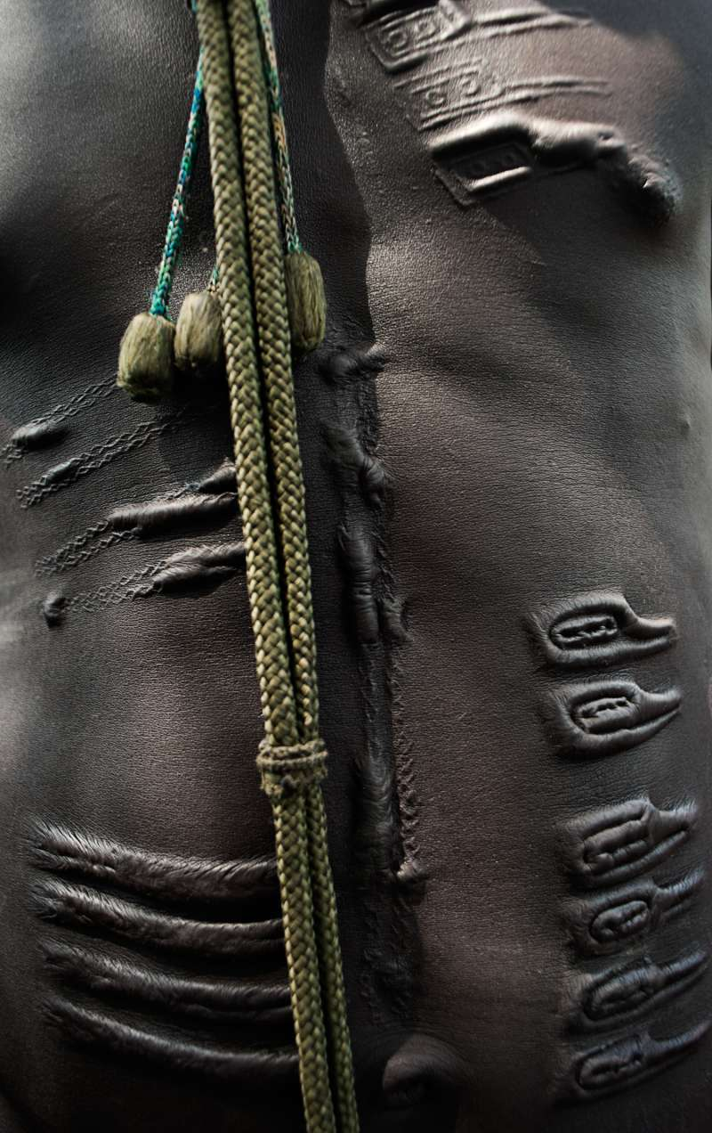 boy of the Muerle tribe, another group living in the region, shows off his tribal markings.