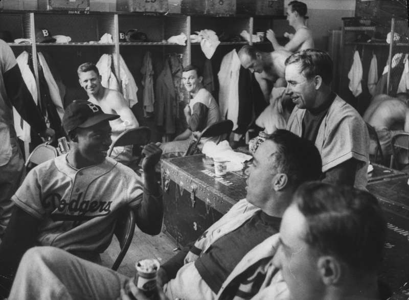 By the 1950s, the Dodgers were multicultural enough that Cuban Sandy Amoros (far left) joked easily with Pee Wee Reese (on trunk) and Duke Snider (with beer).