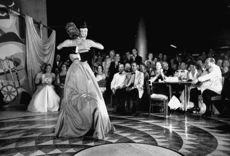 Hilton hugs Mary Martin in the ballroom of a new property.