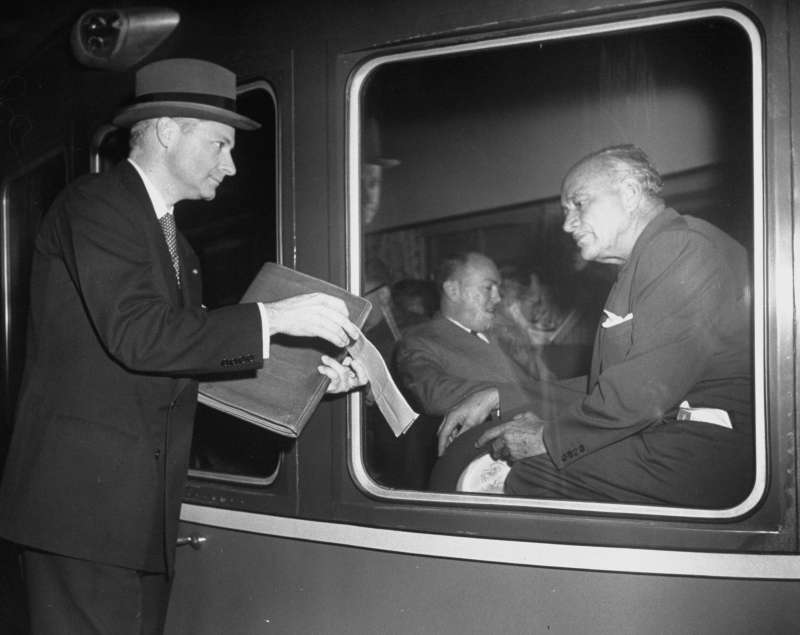 Hilton looks over a telegram held by his vice president, Joseph P. Binns. On , the character was portrayed as having little sympathy or patience for the personal lives of his employees; the fictional Hilton often called Don Draper with requests in the dead of night.