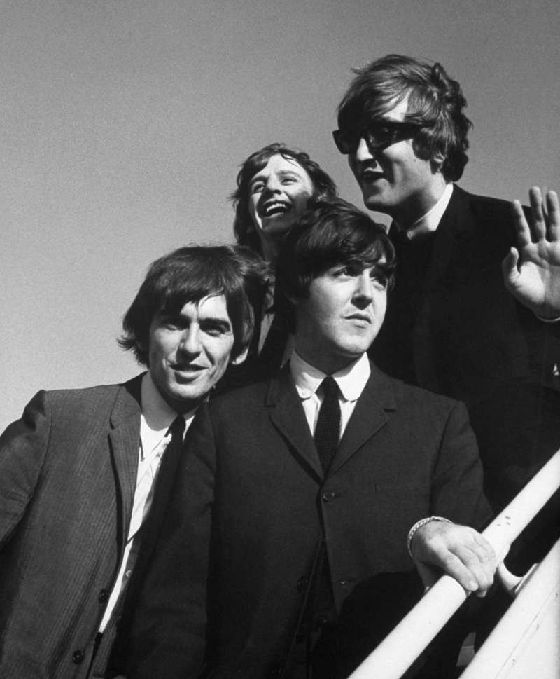 The Beatles wave to fans as they arrive at the Los Angeles airport in August 1964 for a press conference at the start of their second American tour.