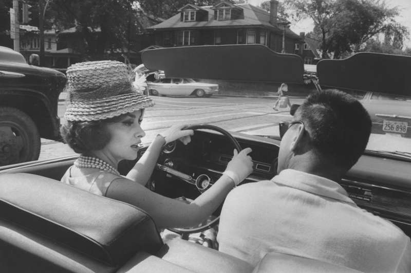 Gina Lollobrigida takes a driving lesson through the streets of Toronto.