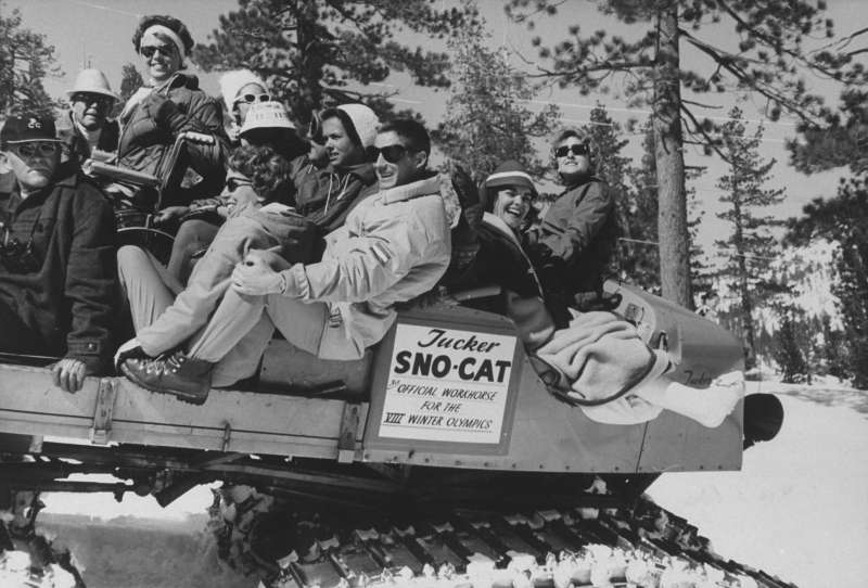 Squaw Valley Olympic athletes ride  The Cripple Cat,  a Sno-Cat meant to transport competitors who happened to get injured during the games.