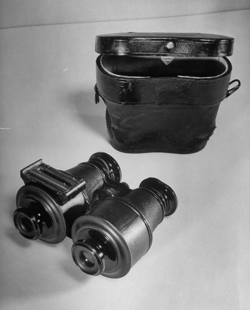 Camera disguised as a pair of binoculars, with one dummy lens.