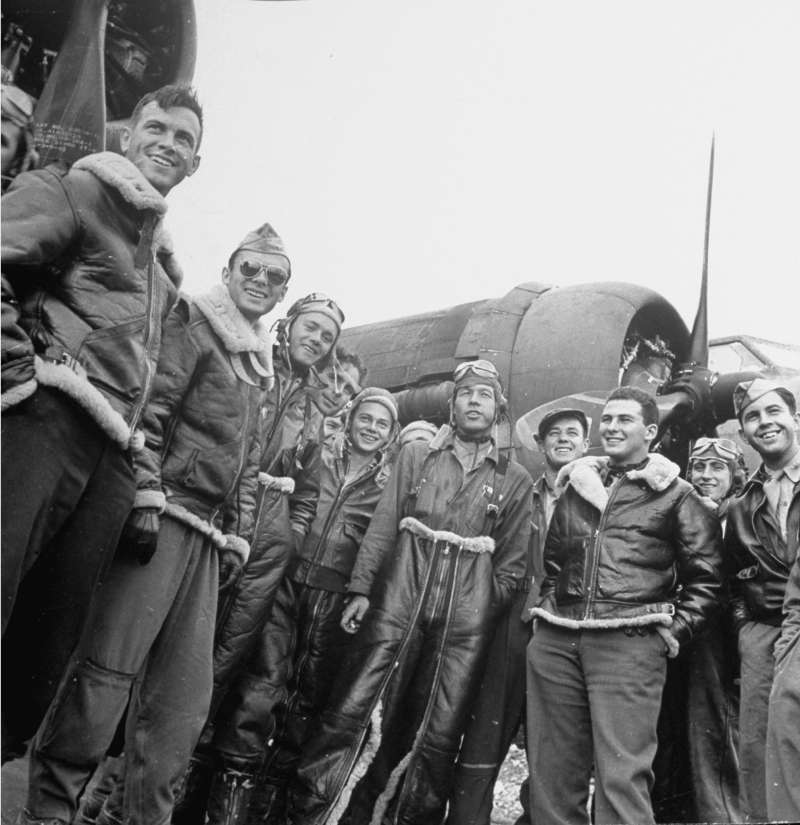 Jubilant B-17 Flying Fortress crew pose after returning unscathed from a bombing raid in September 1942.