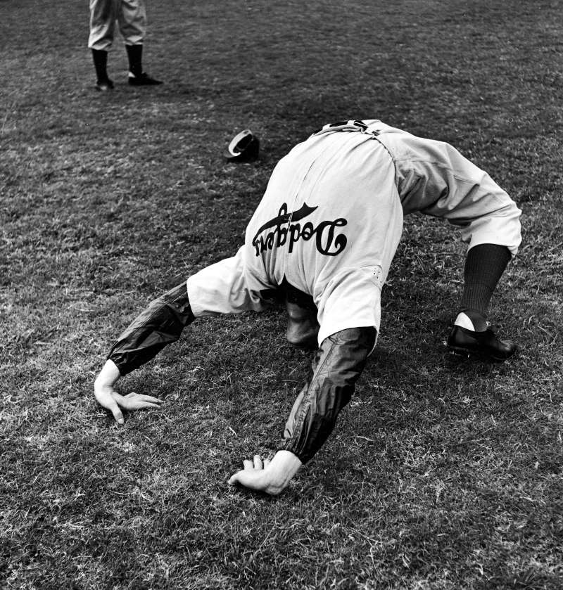 Ed Albosta does a backbend to limber up during the 1942 spring training in Havana.