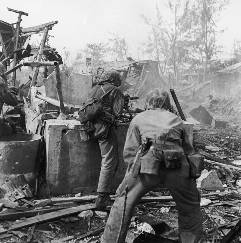 Under Fire                              United States Marines advance on positions held by Japanese forces in Tanapag, Saipan, June 1944.