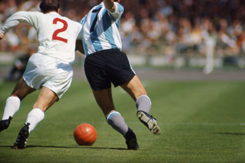 England's George Cohen vies with Argentina's Silvio Marzolini during a World Cup quarterfinal match, 1966.