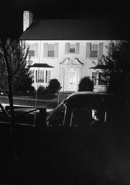 Secret Service agents keeping watch in car outside Richard M. Nixon's home in 1955, during time of Dwight D. Eisenhower's illness, when Nixon was acting President.