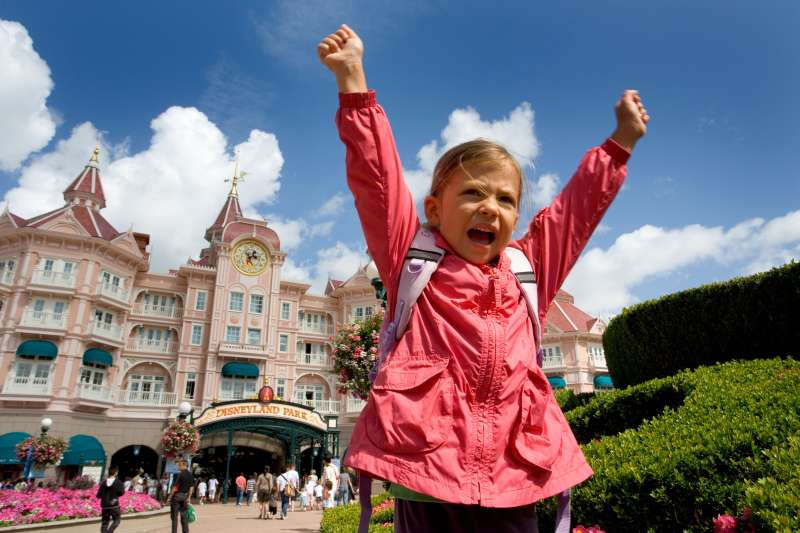 A child shows excitement at the entrance to Disneyland Paris, France. Image shot 07/2009. Exact date unknown.