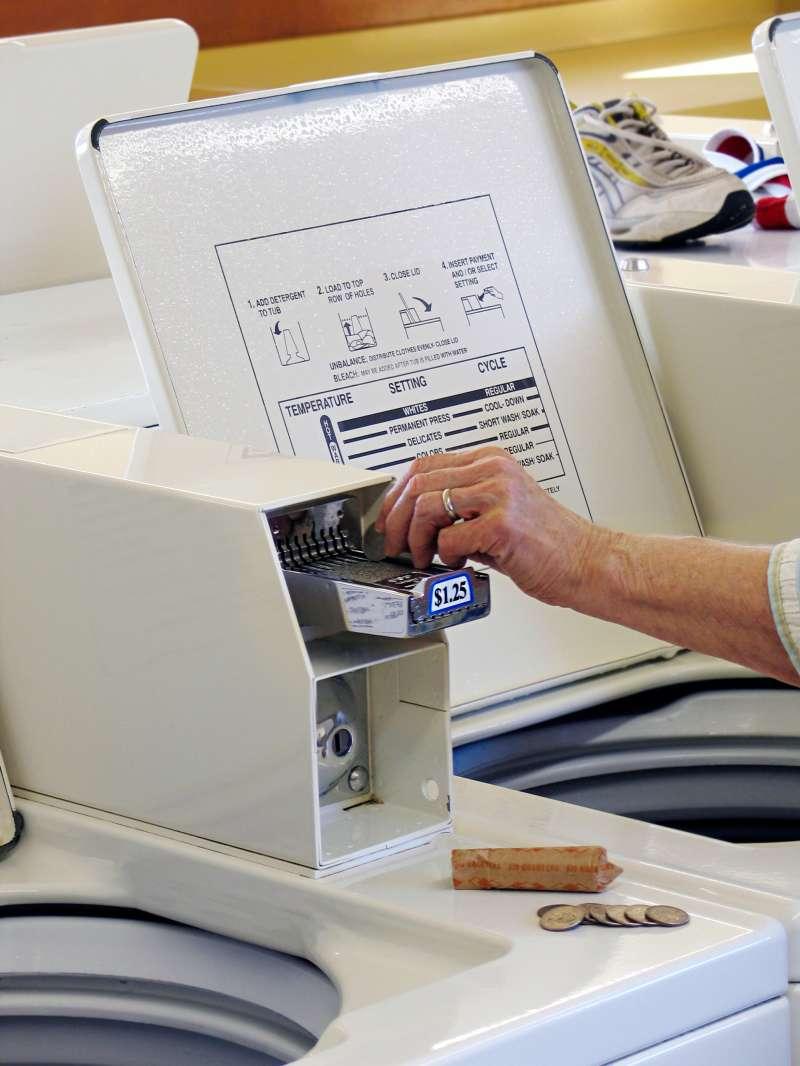 Putting quarters in laundry machine