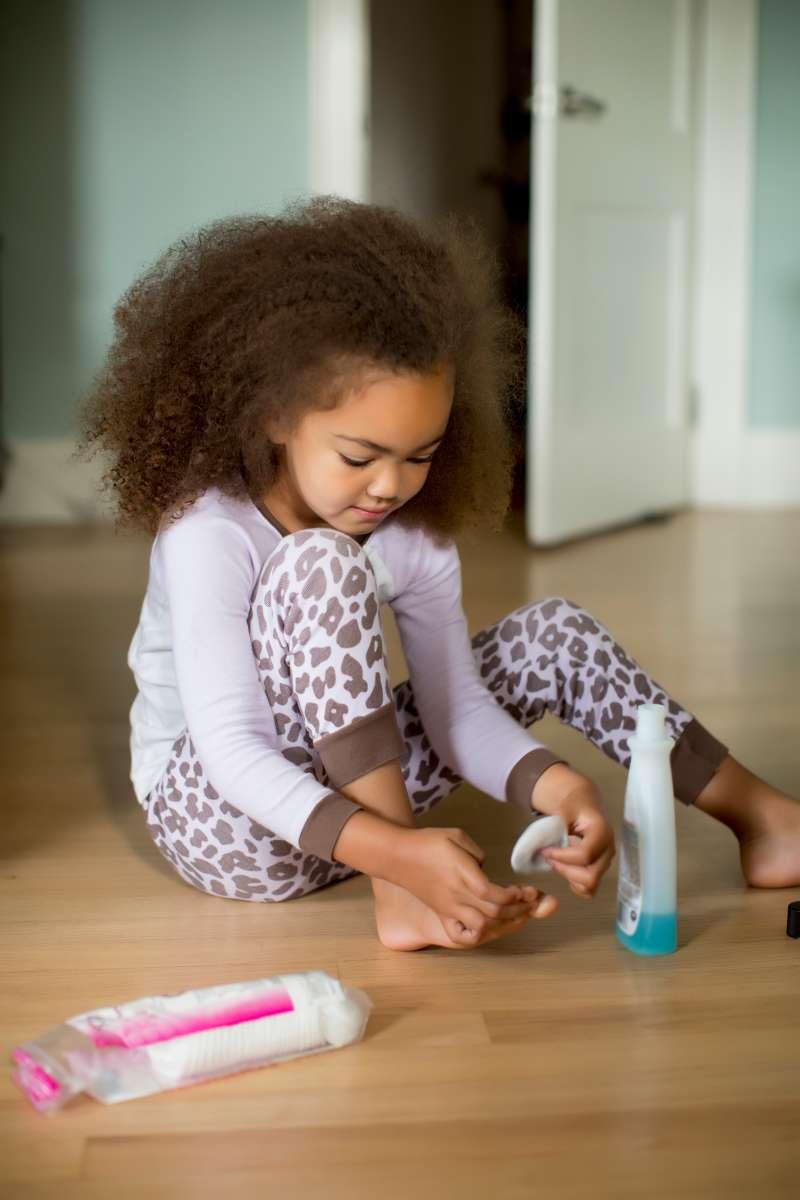Girl removing nail polish