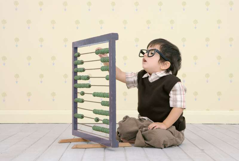 Kid learning to use abacus