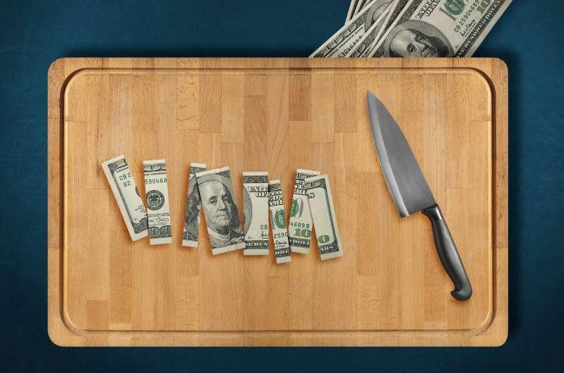 sliced dollar bill on cutting board