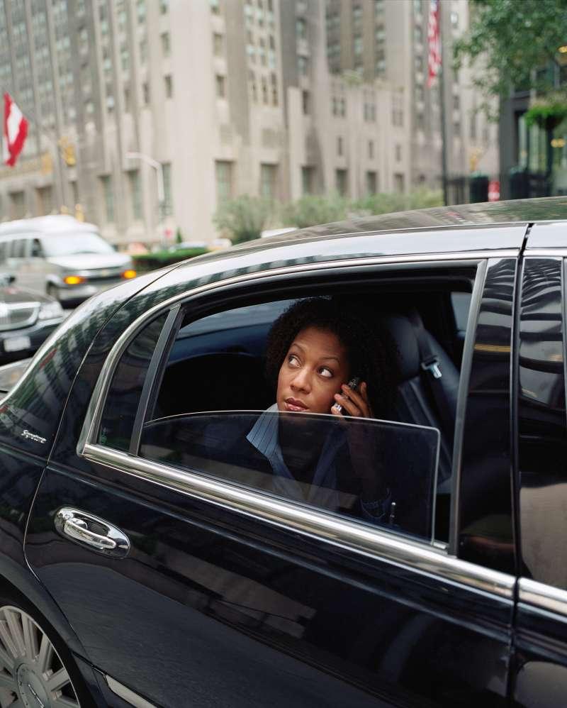 Businesswomen in a black car