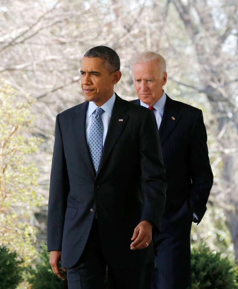 U.S. President Barack Obama (L) walks out next to Vice President Joseph Biden.