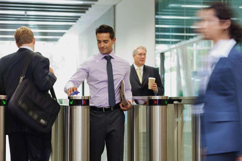 Employee walking through office building security gate