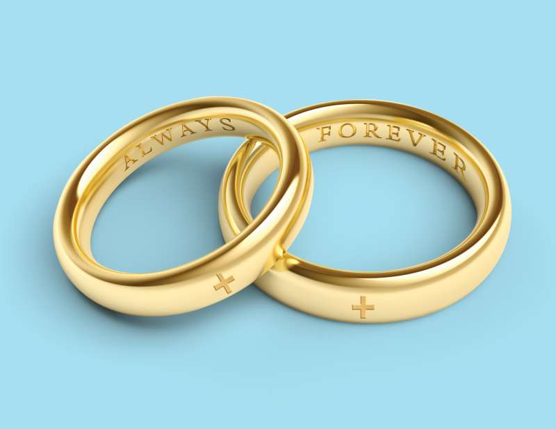 Wedding rings with health cross on them
