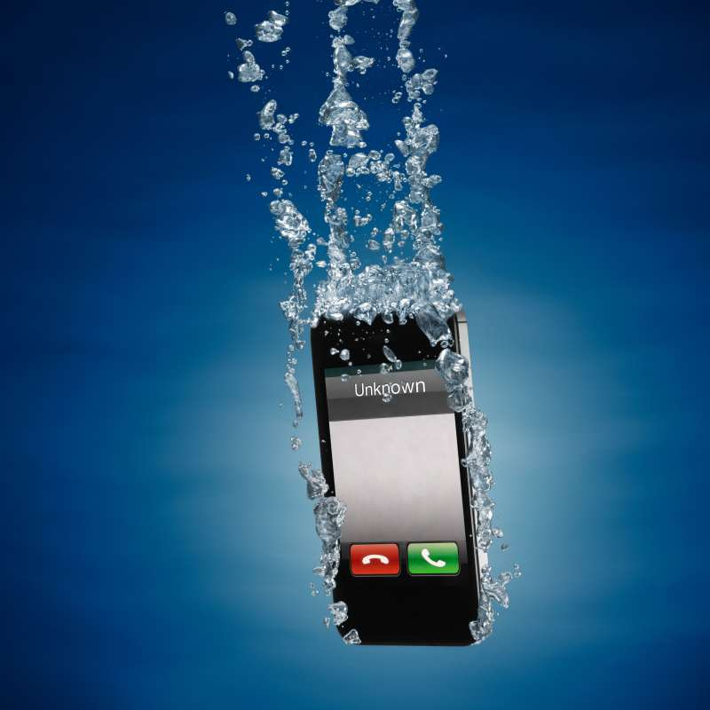 iPhone submerged in water