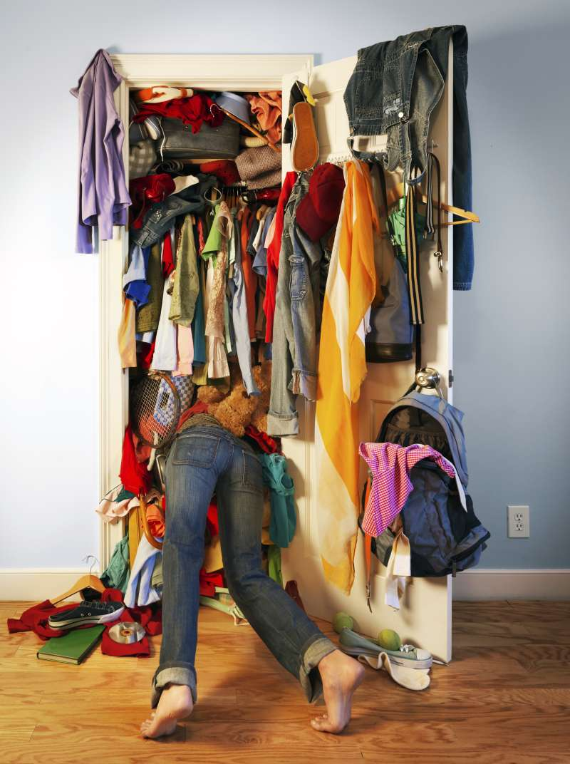 Digging in overflowing closet
