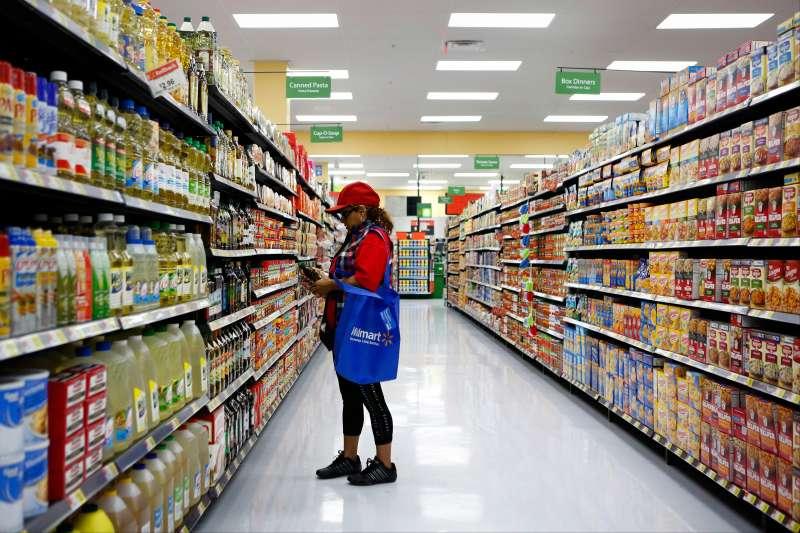 Female shopper in Wal-Mart store aisle