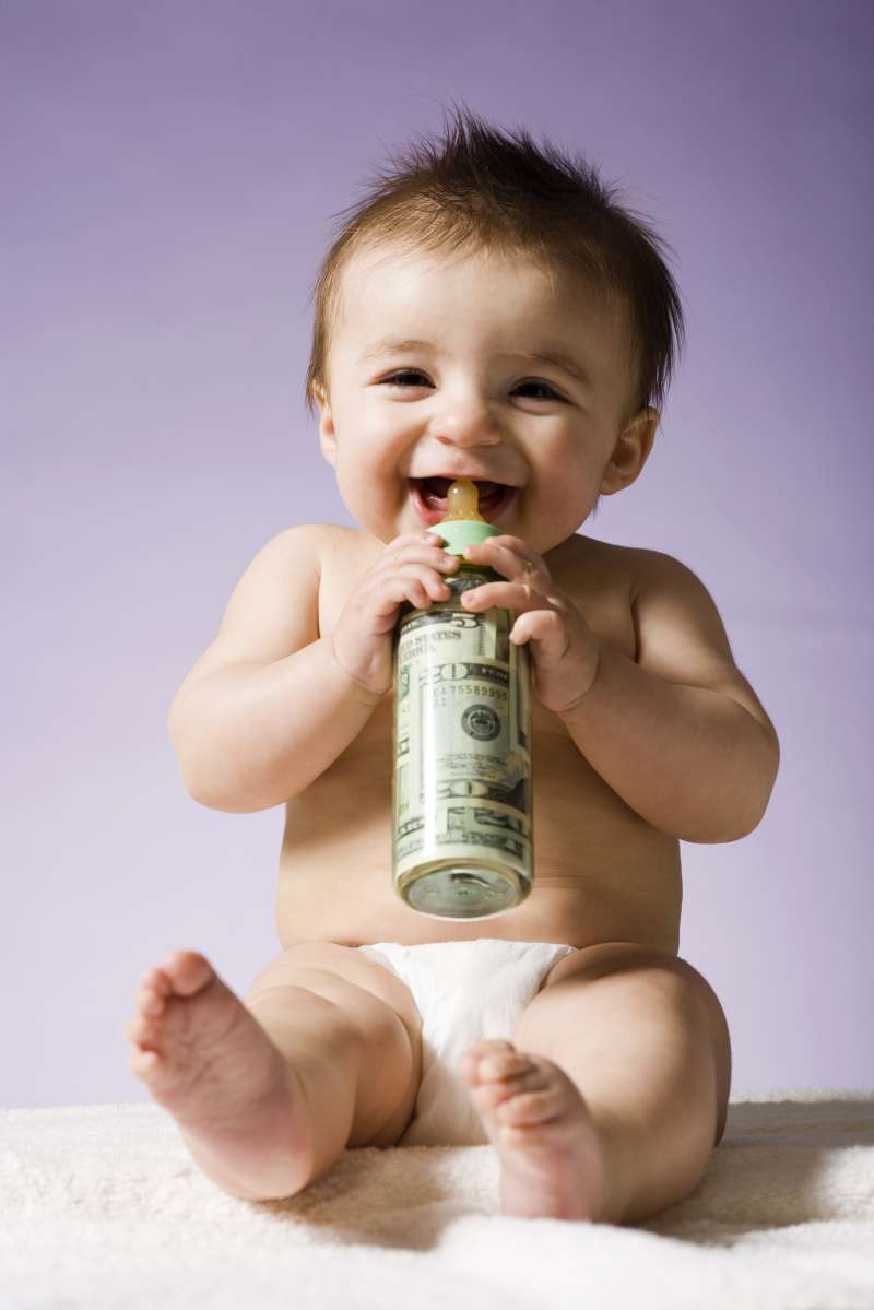 Baby drinking milk bottle filled with cash