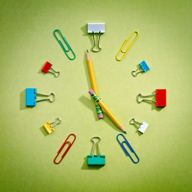 School supplies arranged in clock face formation