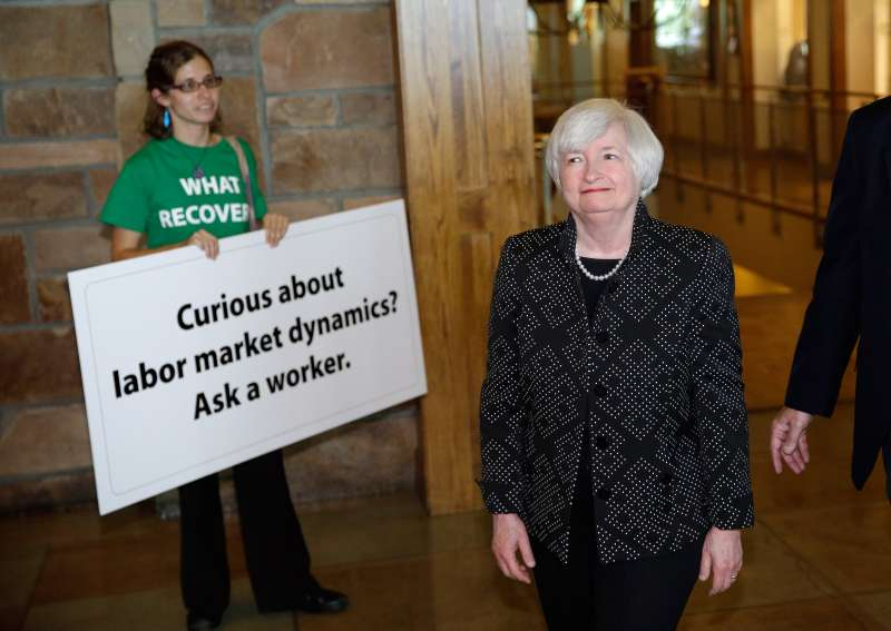 At Jackson Hole, Yellen is greeted by demonstrators who want the Fed to push for more jobs