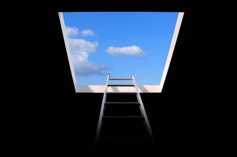 ladder leading to a bright blue sky