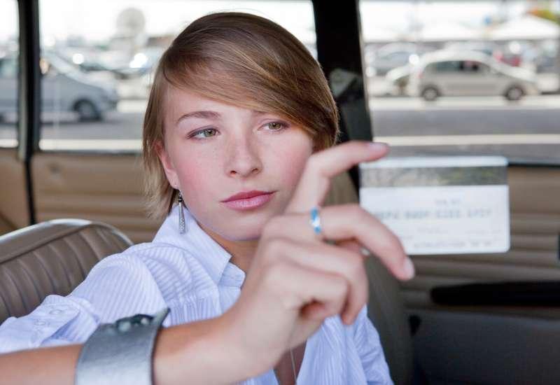 millennial holding credit card
