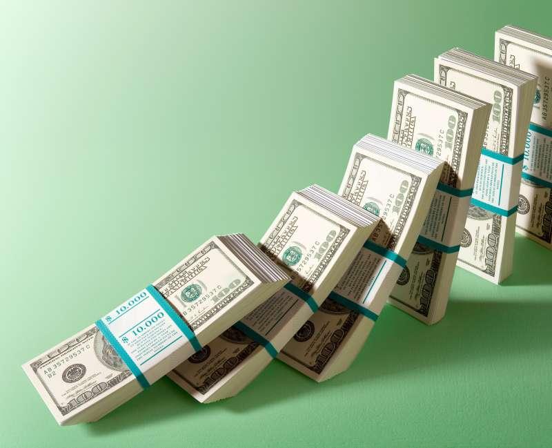 domino stacks of $10,000 bills