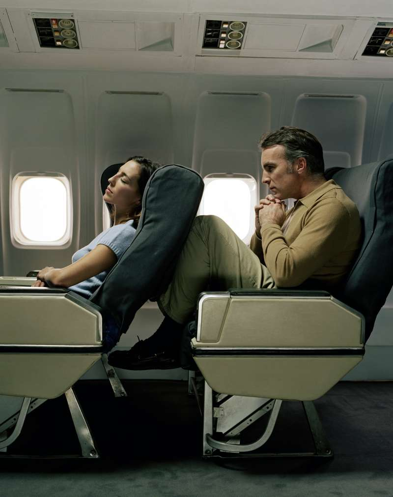 Reclining airplane seat into passenger's knees