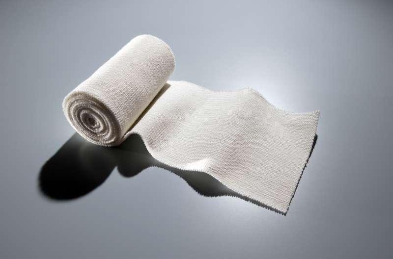 Roll of medical gauze unrolling
