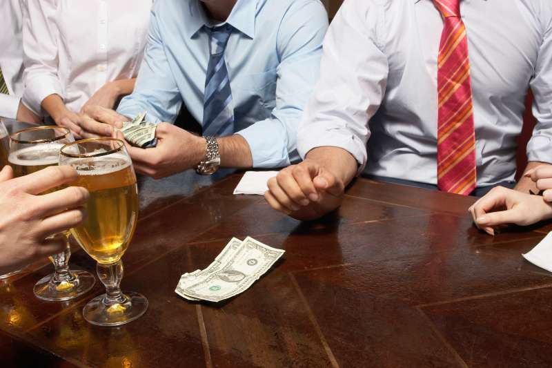 People paying for drinks at bar