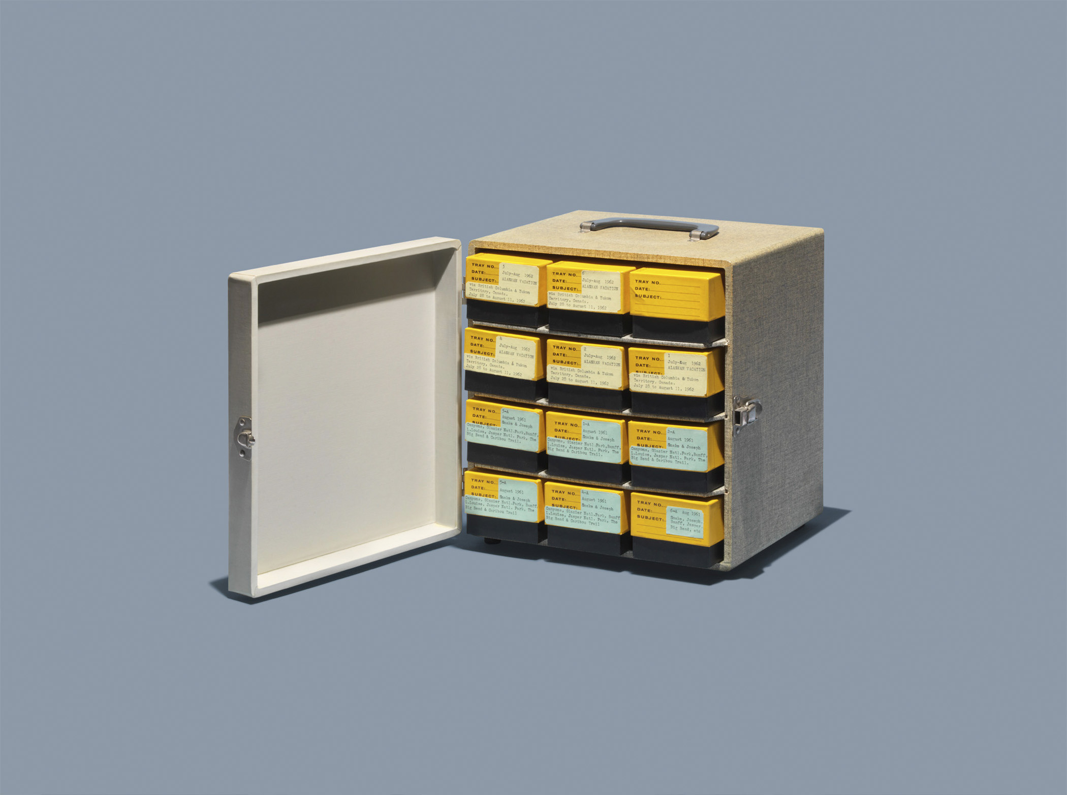 """Kodak 35mm slide caddy. List Price of similar 1951 slide case by Barnett &amp; Jaffe Model SV-3N: $11.25, per <a href=""""http://books.google.com/books?id=f10zAQAAMAAJ&amp;pg=PA137&amp;dq=Barnett+%26+Jaffe++slide+storage+case&amp;hl=en&amp;sa=X&amp;ei=VGscVOioAcT9yQSNv4GQDA&amp;ved=0CDIQ6AEwAQ#v=onepage&amp;q=Barnett%20%26%20Jaffe%20%20slide%20storage%20case&amp;f=false"""" title=""""Popular Photography"""" target=""""_blank"""">Popular Photography</a>.  <strong>Today's equivalent:</strong> Phase One Media Pro. List Price: $445, available on <a href=""""http://www.phaseone.com/Online-Store/PurchaseDetailsPage.aspx?mediapro=buy"""" title=""""Phase One Media Pro"""" target=""""_blank"""">PhaseOne.com</a>."""