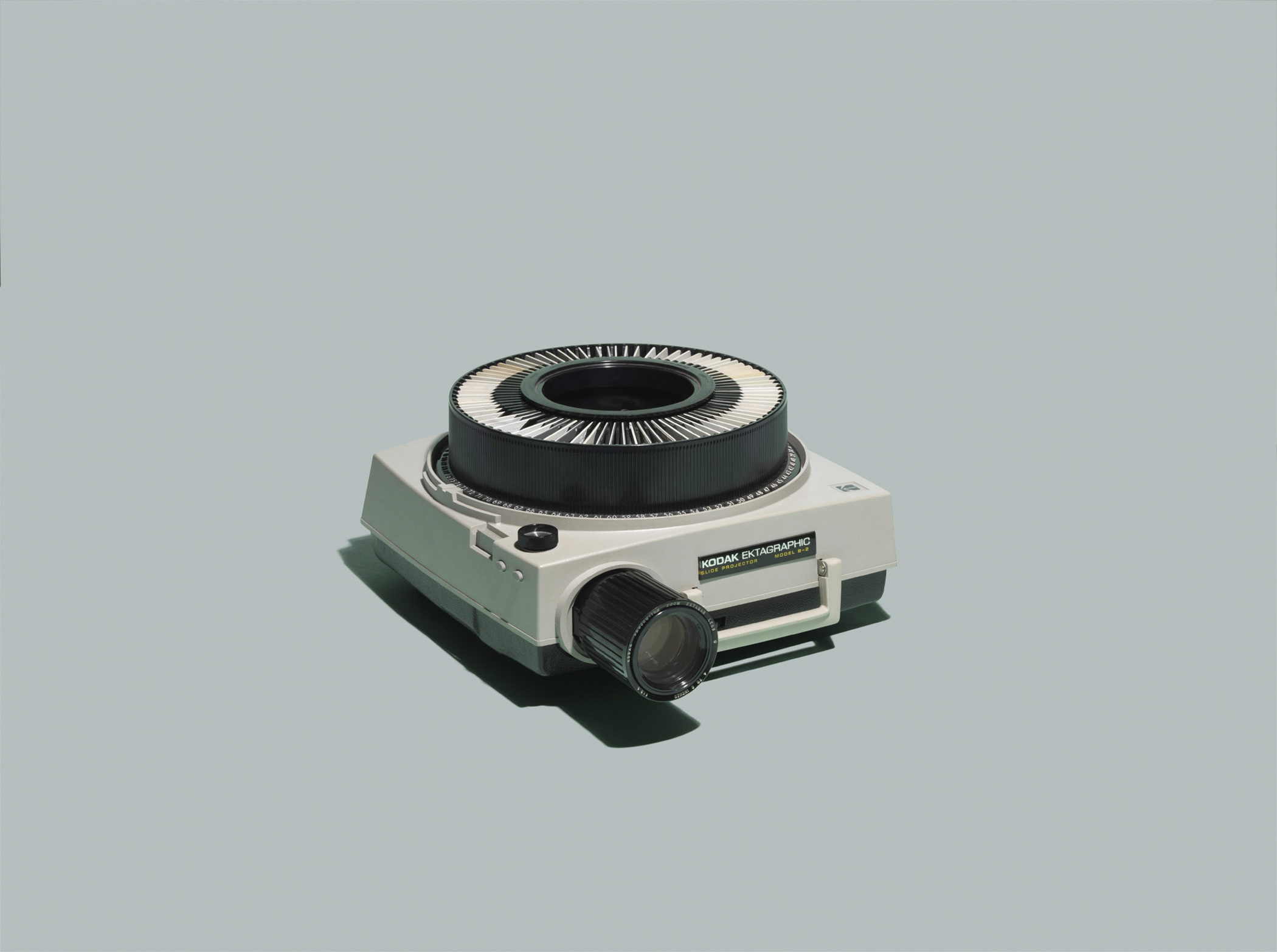 """Kodak Ektagraphic Slide Projector, Model B-2. 1982 List Price: $169, per <a href=""""http://books.google.com/books?id=2Q_myLjG1_0C&amp;pg=PT27&amp;dq=Kodak+Ektagraphic+Slide+Projector,+Model+B-2&amp;hl=en&amp;sa=X&amp;ei=IjkcVOnxCPDhsAT1jYKoBg&amp;ved=0CD0Q6AEwAQ#v=onepage&amp;q=Kodak%20Ektagraphic%20Slide%20Projector%2C%20Model%20B-2&amp;f=false"""" title=""""Popular Photography"""" target=""""_blank"""">Popular Photography</a>.  <strong>Today's equivalent:</strong> MS PowerPoint, part of Microsoft Office 365 Personal. List Price: $69.99, available at <a href=""""http://bit.ly/YYjlFX"""" title=""""Best Buy"""" target=""""_blank"""">Best Buy</a>."""