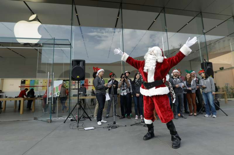 Mark Cerqueria, software engineer for the application software company Smule, performs as Santa Claus