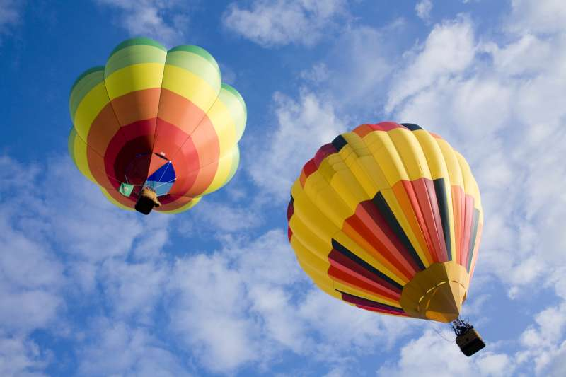 Hot air balloons floating higher and higher