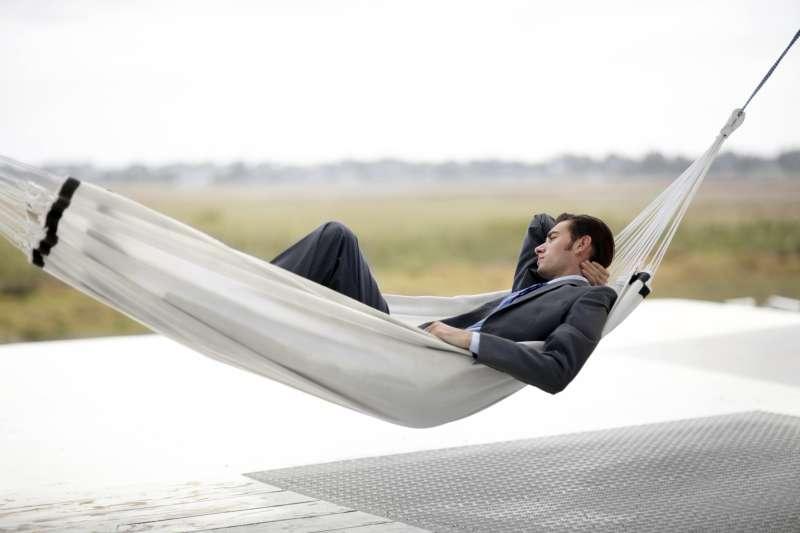 Man in business suit in hammock
