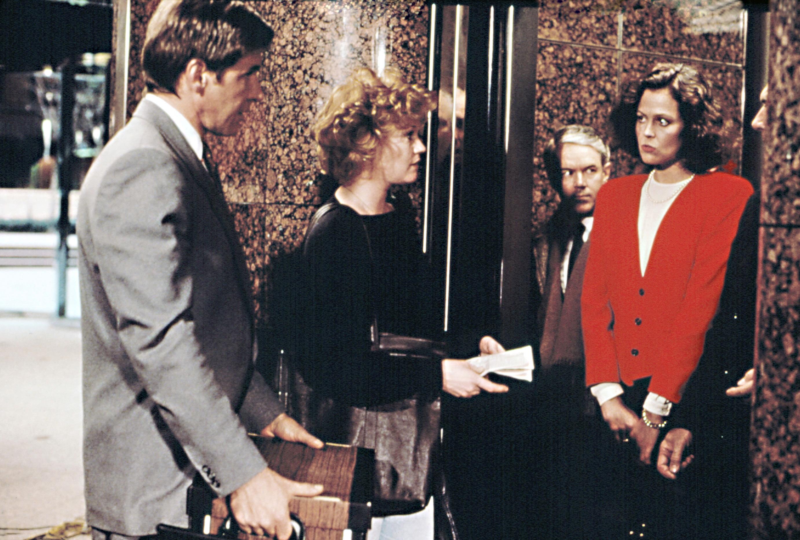 WORKING GIRL, Harrison Ford, Melanie Griffith, Sigourney Weaver, 1988.