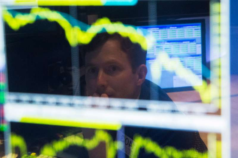 A trader watches the screen at his terminal on the floor of the New York Stock Exchange in New York October 15, 2014.