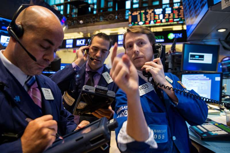 Traders work on the floor of the New York Stock Exchange October 15, 2014.