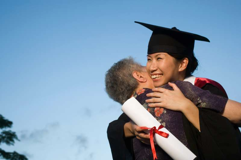 granddaughter hugging grandma after graduating from college