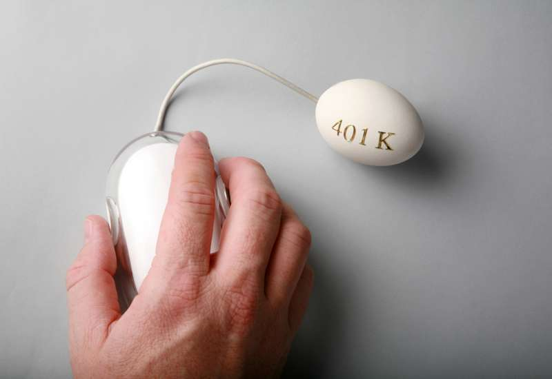 hand clicking Apple mouse connected to egg with 401k on it