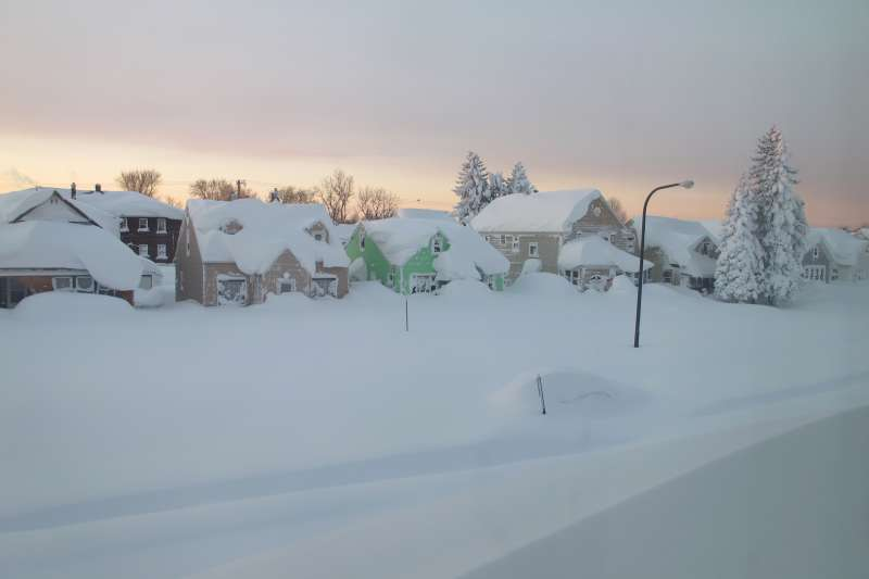 Snow covers a street at daybreak Wednesday, Nov. 19, 2014, in south Buffalo, N.Y.
