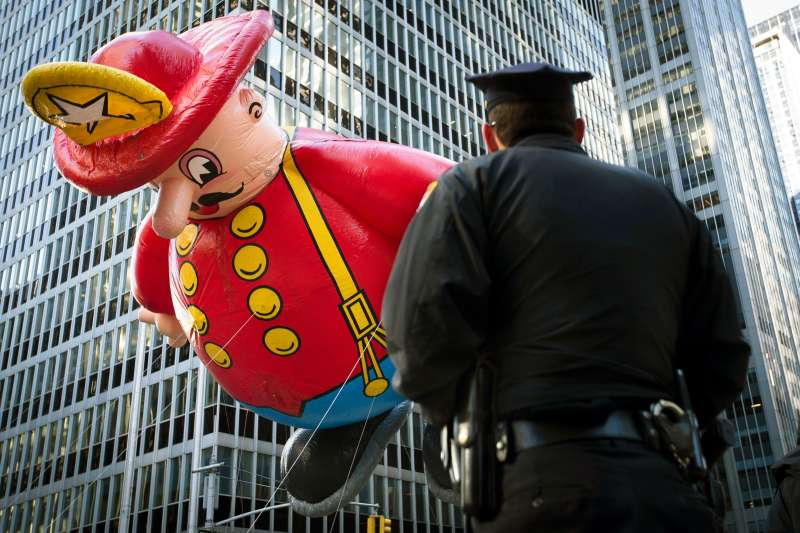 policeman watching the Macy's Thanksgiving day parade