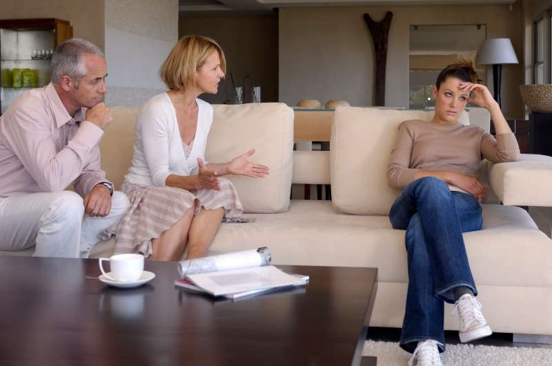 parents trying to talk to teenage daughter