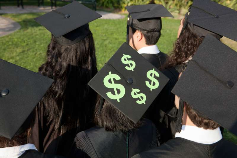 Graduates with $$ on their caps