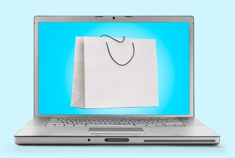 Laptop with shopping bag on screen