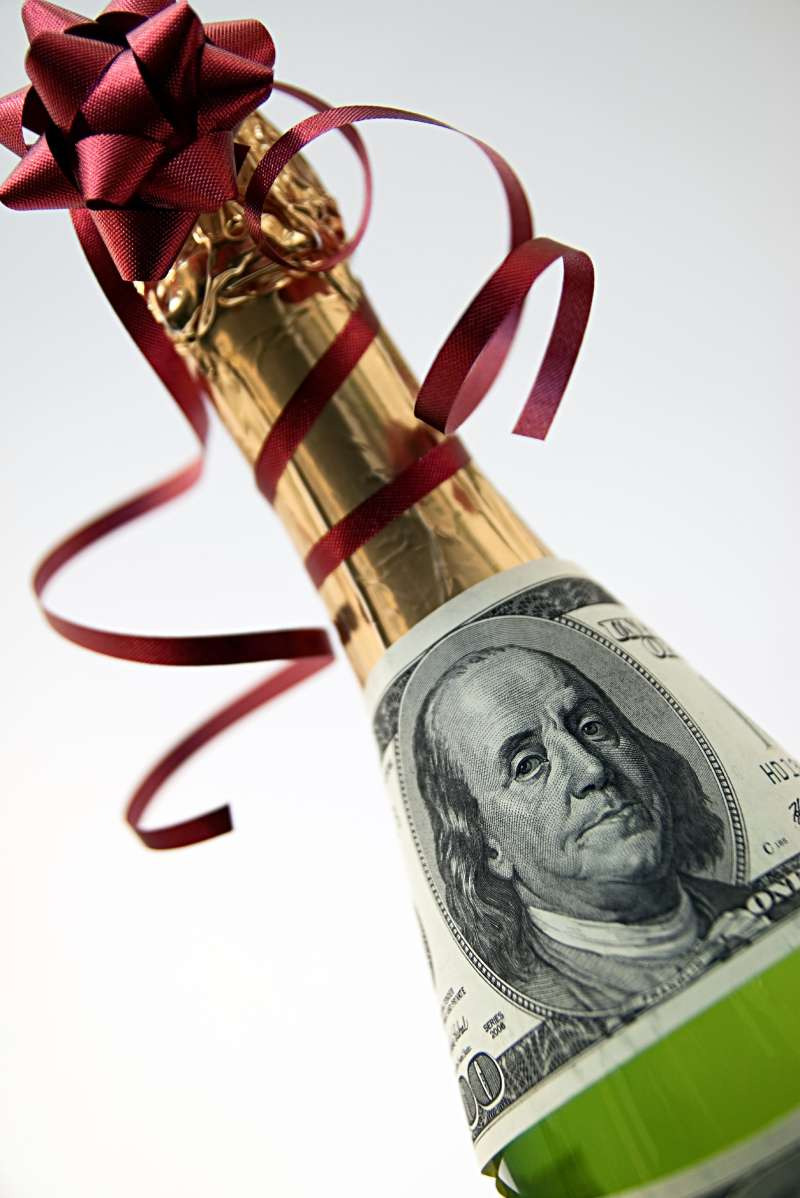 champagne bottle with $100 bill wrapped around it